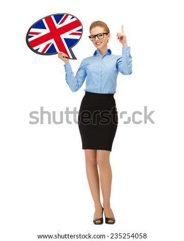 education, foreign language, english, people and communication concept - smiling woman holding text bubble of british flag and pointing finger up - stock photo