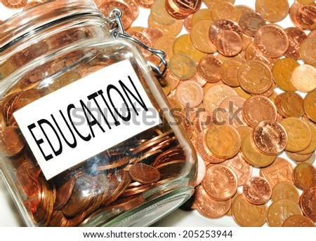 Education fund concept with jar of money - stock photo
