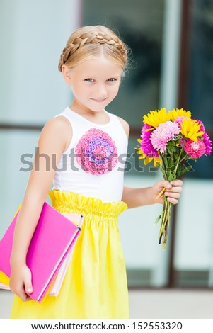 Education - funny girl with a book and flowers - stock photo