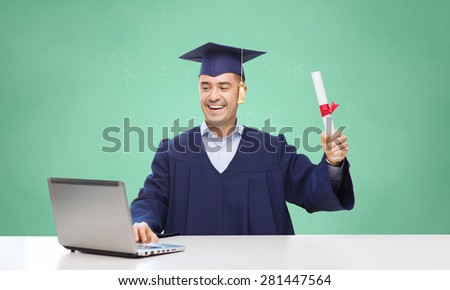 education, graduation, technology and people concept - happy adult student in mortarboard with diploma and laptop computer sitting at table over green school chalk board background - stock photo