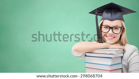 education, high school, knowledge, and people concept - picture of happy student girl or woman in trencher cap with stack of books over green chalk board background - stock photo