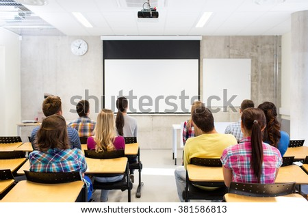 education, high school, learning and people concept - group of students sitting in lecture hall