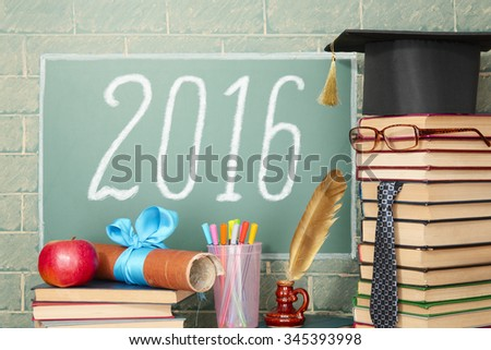 Education idea with unusual teacher before blackboard with title 2016 - stock photo