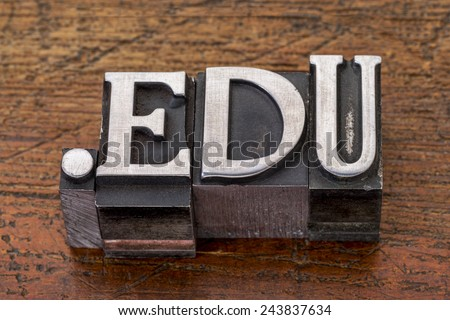 education internet  domain - dot edu in mixed vintage metal type printing blocks over grunge wood - stock photo