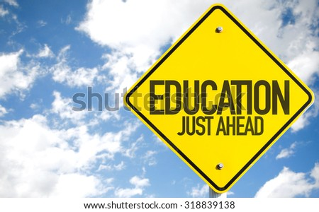 Education Just Ahead sign with sky background - stock photo