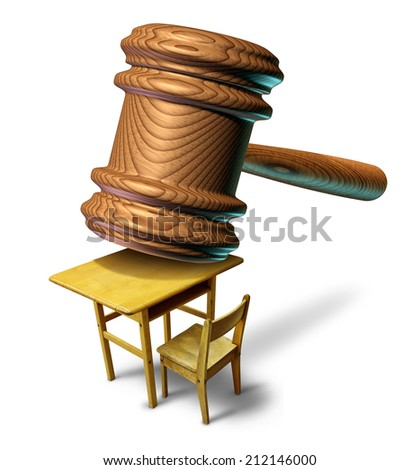 Education law and school justice with a judge mallet or judges wooden gavel hammering a student class desk as a metaphor for public safety teacher or student abuse with a lawyer or attorney guidance  - stock photo