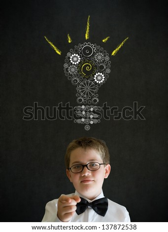 Education needs you thinking boy dressed up as business man with bright idea gear cog lightbulb on blackboard background - stock photo