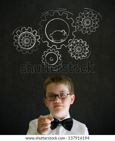 Education needs you thinking boy dressed up as business man with chalk turning gear cogs and running hamster on blackboard background - stock photo