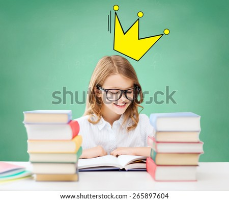 education, people, children and school concept - student girl sitting at table and reading book over green chalk board background and crown doodle - stock photo
