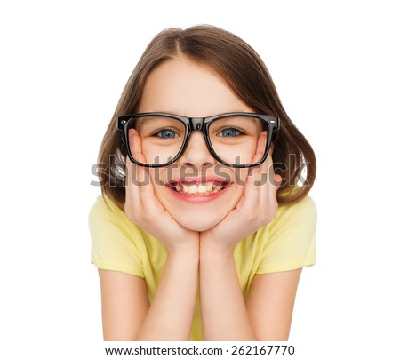 education, school and vision concept - smiling cute little girl in black eyeglasses - stock photo