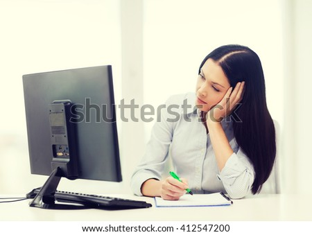 education, school, business and technology concept - tired businesswoman or student studying