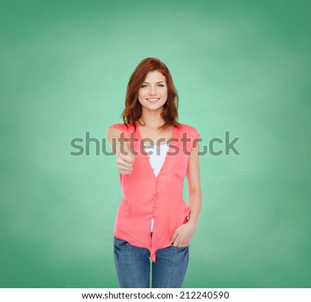 education, school, gesture and people concept - smiling teenage girl in casual clothes showing thumbs up over green board background - stock photo