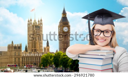 education, school, knowledge and people concept - picture of happy student girl or woman in trencher cap with stack of books over houses of parliament in london city background - stock photo