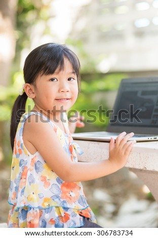 education, school, technology and internet concept - Cute girl with laptop pc at home - stock photo