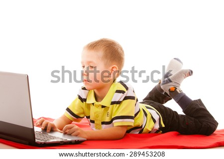 Education, school, technology and internet concept - little student boy with laptop pc computer