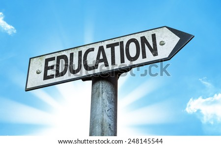 Education sign with a beautiful day - stock photo