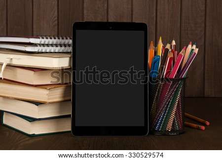 Education still life. School supplies and digital tablet - stock photo