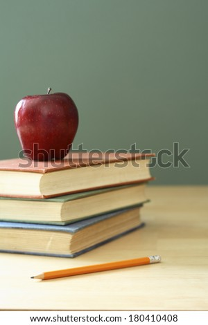 education still life with apple, books, pencil