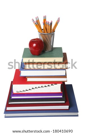 education still life with stack of books, apple, and cup of pencils on white  - stock photo
