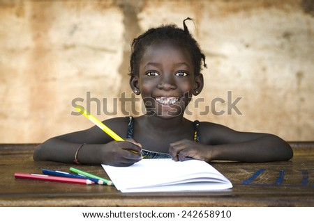 Education Symbol: Big Toothy Smile on African School Girl - stock photo