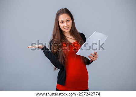 Education, technology and people concept. Girl with paper and pen presenting a copyspace