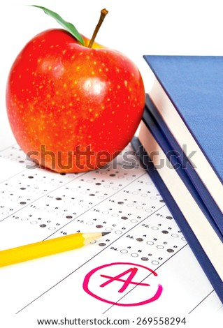 Education. Test score sheet with apple and books - stock photo