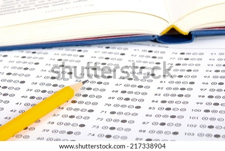 Education. Test sheet and book - stock photo