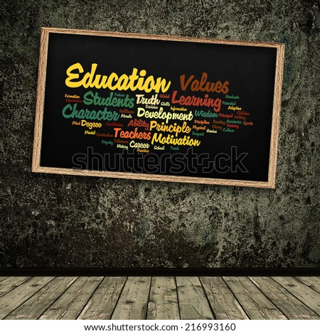 Education word cloud shown on a grungy school chalkboard/blackboard :collage illustrating the concept of education and the words associated with it   - stock photo