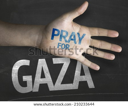 Educational and Creative composition with the message Pray for Gaza on the blackboard - stock photo