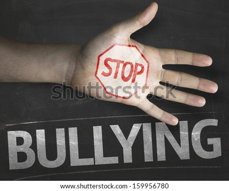 Educational and Creative composition with the message Stop Bullying on the blackboard - stock photo