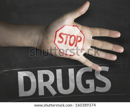 Educational and Creative composition with the message Stop Drugs on the blackboard - stock photo