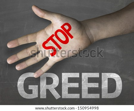 Educational and Creative composition with the message Stop Greed on the blackboard - stock photo