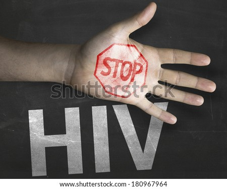 Educational and Creative composition with the message Stop HIV on the blackboard - stock photo