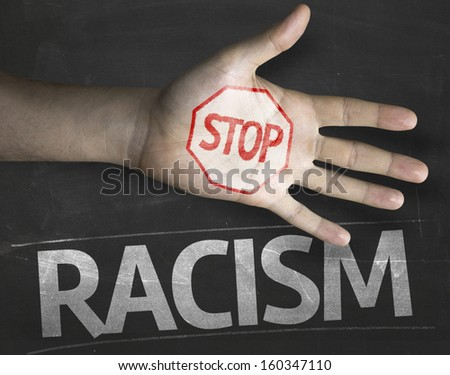 Educational and Creative composition with the message Stop Racism on the blackboard - stock photo
