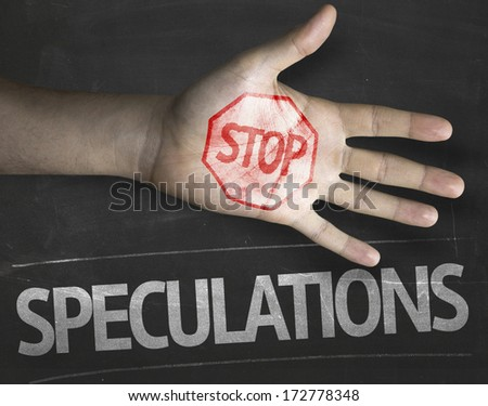 Educational and Creative composition with the message Stop Speculations on the blackboard - stock photo