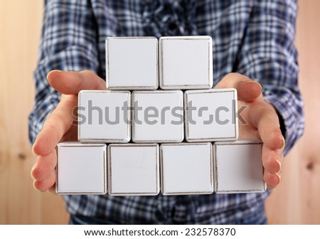 Educational cubes in hands, close-up - stock photo