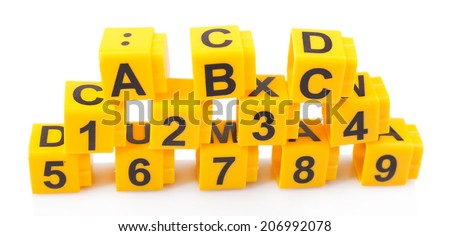 Educational cubes with different numbers and letters isolated on white - stock photo