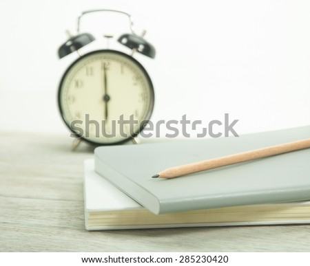 Educational Equipment (Pencil and book) - stock photo