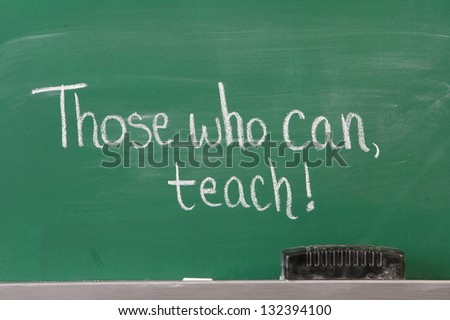 Educational Inspirational Phrase for teachers written on chalkboard. - stock photo