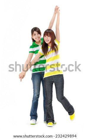 Educational theme: casual two woman smiling friends - stock photo