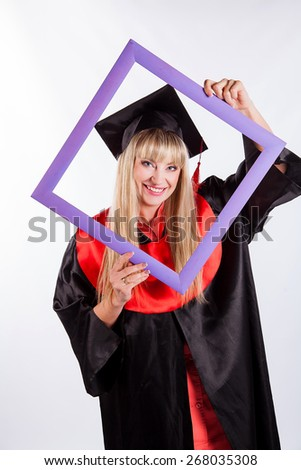 Educational theme: graduating student girl in an academic gown holds the frame. Isolated over white background. - stock photo