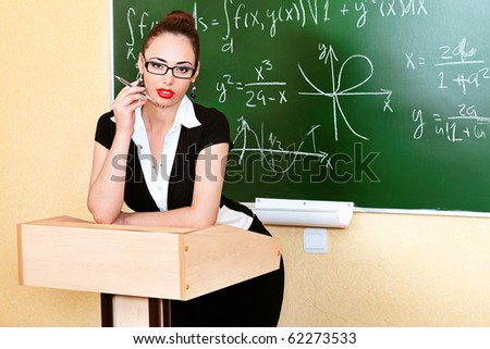 Educational theme: portrait of an attractive teacher. - stock photo