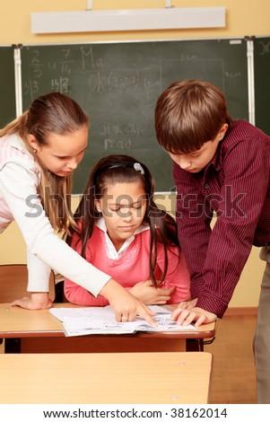 Educational theme: schoolchildren in a classroom. - stock photo