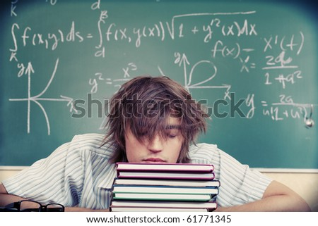 Educational theme: tired student in a classroom.