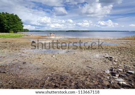 Effect of global warming on the lake - stock photo