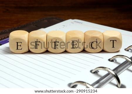 EFFECT word written on wood block - stock photo