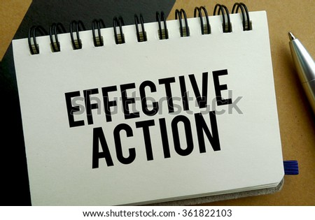 Effective action memo written on a notebook with pen