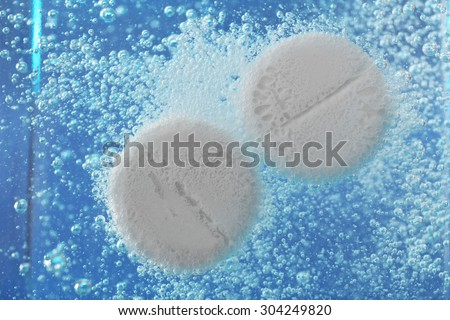 Effervescent painkiller tablets in water, closeup - stock photo