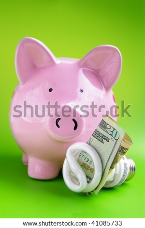 efficient light bulb and piggy bank, with cash - stock photo