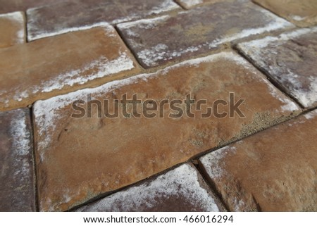 Efflorescence on the modern concrete parking tiles